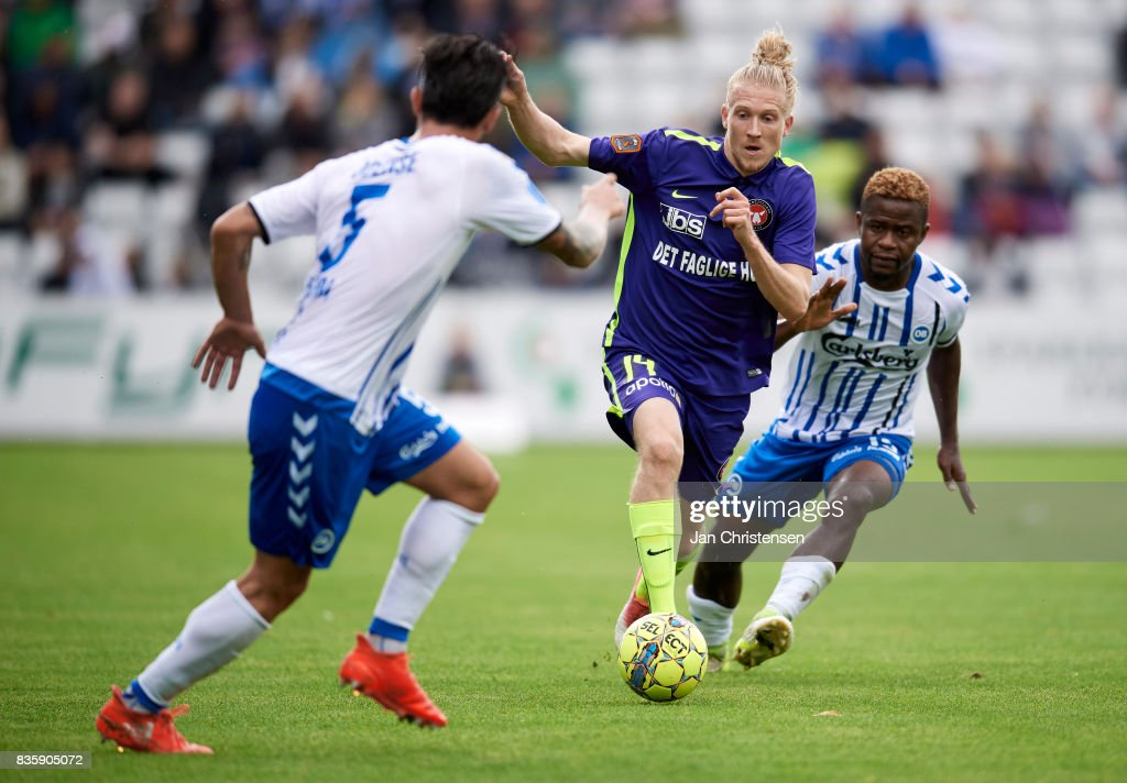 Simon Kroon of FC Midtjylland and Izunna Uzochukwu of OB Odense compete for the ball during the Danish Alka Superliga match between OB Odense and FC Midtjylland at TREFOR Park on August 20, 2017 in Odense, Denmark.