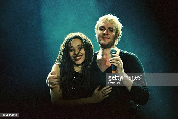 Simon Le Bon of Duran Duran with one of their backing singers perform on stage at Wembley Arena on January 28th 1994 in London England
