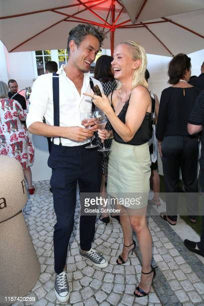 """Simon Lohmeyer and Janin Ullmann during the """"Ein Abend mit Franciacorta"""" event at Villa Wagner on July 23, 2019 in Munich, Germany."""