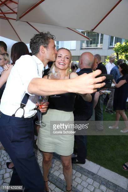 """Simon Lohmeyer and Janin Ullmann take a selfie during the """"Ein Abend mit Franciacorta"""" event at Villa Wagner on July 23, 2019 in Munich, Germany."""