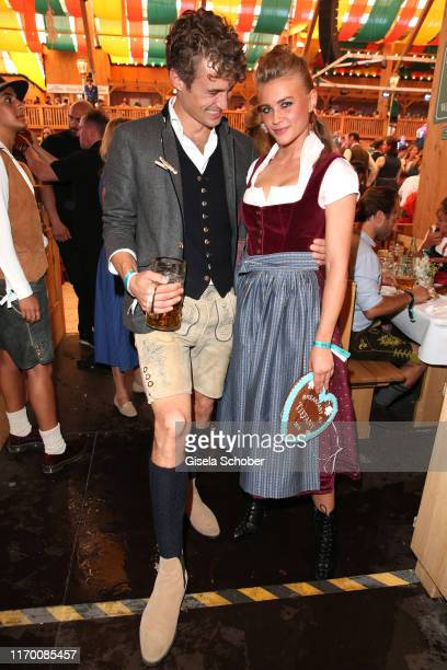 Simon Lohmeyer and Jeanne Goursaud wearing a Dirndl by Amsel Fashion during the Breakfast at Tiffany at Schuetzen Festzelt at the Oktoberfest opening...