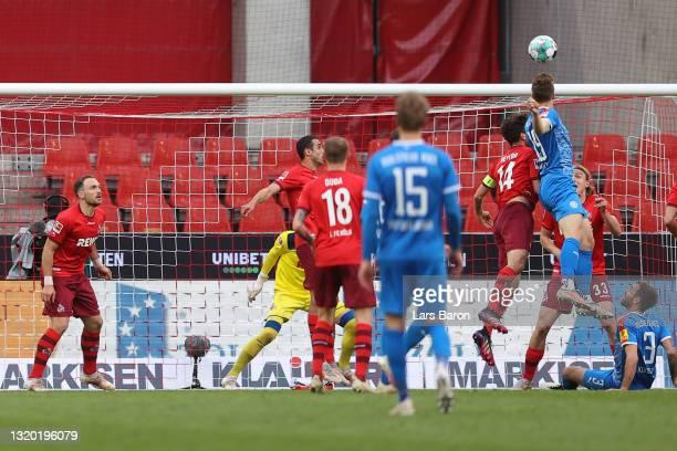 Simon Lorenz of Kiel scores his team's first goal during the Bundesliga playoff first leg match between 1. FC Koeln and Holstein Kiel at...