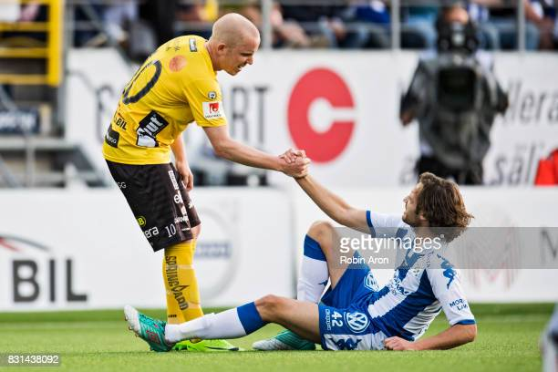 Simon Lundevall of IF Elfsborg helps Mix Diskerud of IFK Goteborg up during the Allsvenskan match between IF Elfsborg and IFK Goteborg at Boras Arena...