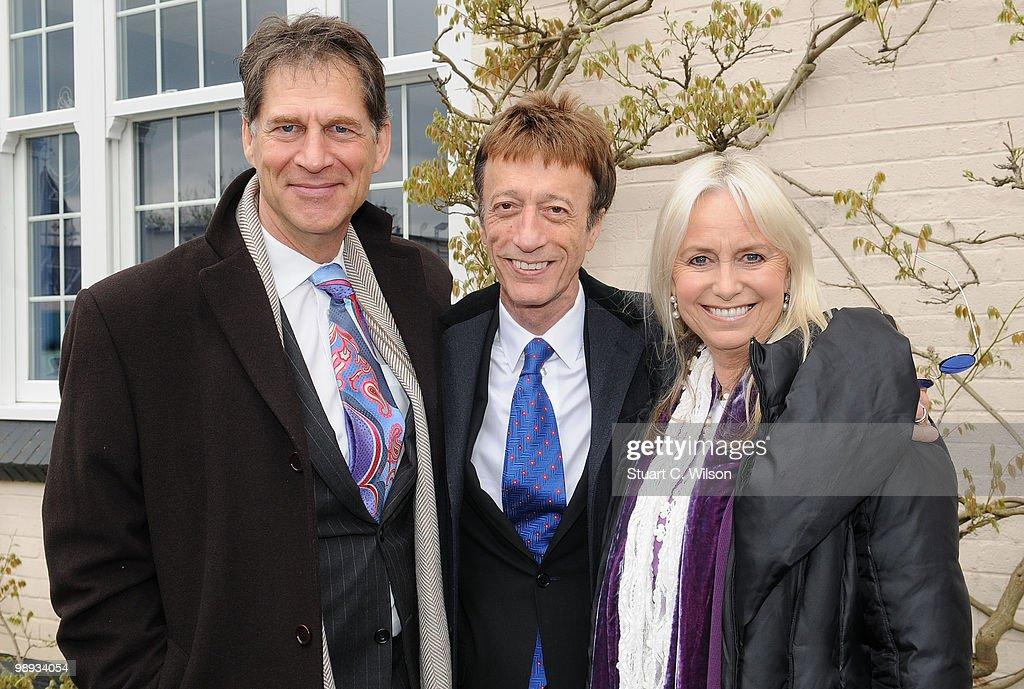 Simon MacCorkindale, Robin Gibb and Susan George attend a plaque unveiling for the late actor, Sir John Mills at Pinewood Studios on May 9, 2010 in London, England.