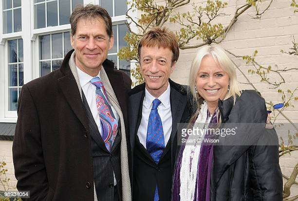 Simon MacCorkindale Robin Gibb and Susan George attend a plaque unveiling for the late actor Sir John Mills at Pinewood Studios on May 9 2010 in...