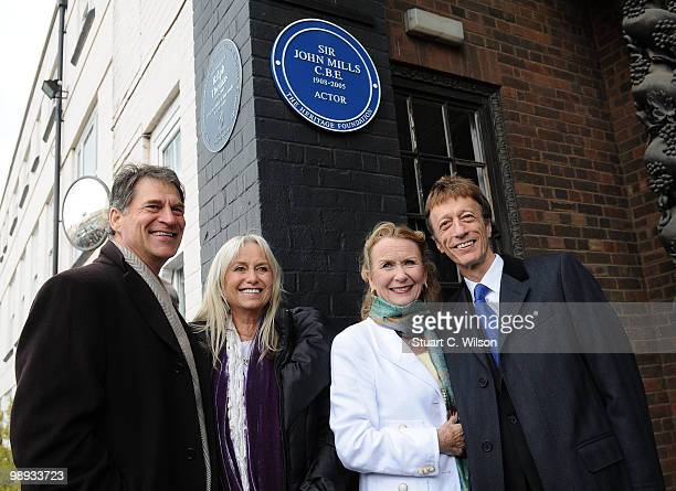 Simon MacCorkindale Susan George Juliet Mills and Robin Gibb attend a plaque unveiling for the late actor Sir John Mills at Pinewood Studios on May 9...