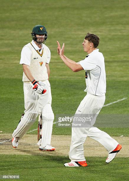 Simon Mackin of Western Australia celebrates after claiming the wicket of Alex Doolan of Tasmania during day two of the Sheffield Shield match...