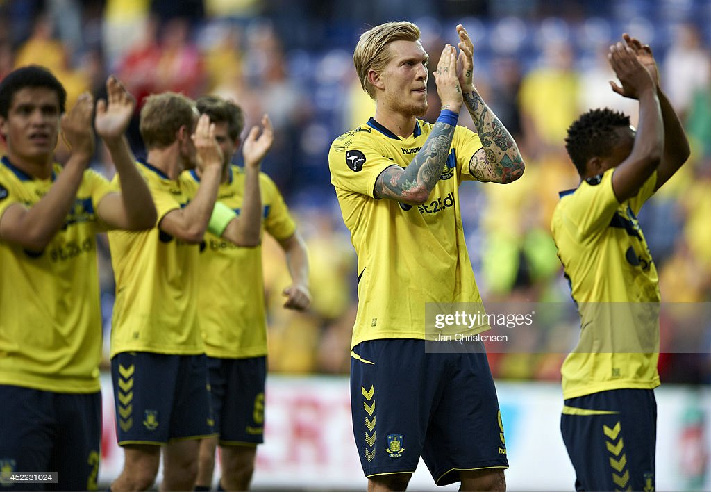Simon Makienok Christoffersen of Brondby IF and rest of the players og Brondby IF celebrates their victory after the Pre-Season Friendly match between Brondby IF and Liverpool FC at Brondby stadium on July 16, 2014 in Brondby, Denmark.