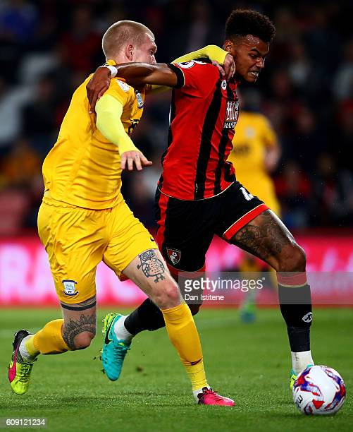 Simon Makienok of Preston North End and Tyrone Mings of AFC Bournemouth in action during the EFL Cup Third Round match between AFC Bournemouth and...