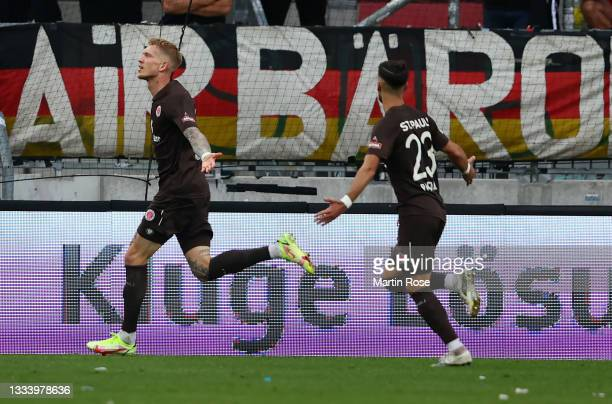 Simon Makienok of St Pauli celebrates with Leart Paqarada after scoring their team's second goal during the Second Bundesliga match between FC St....