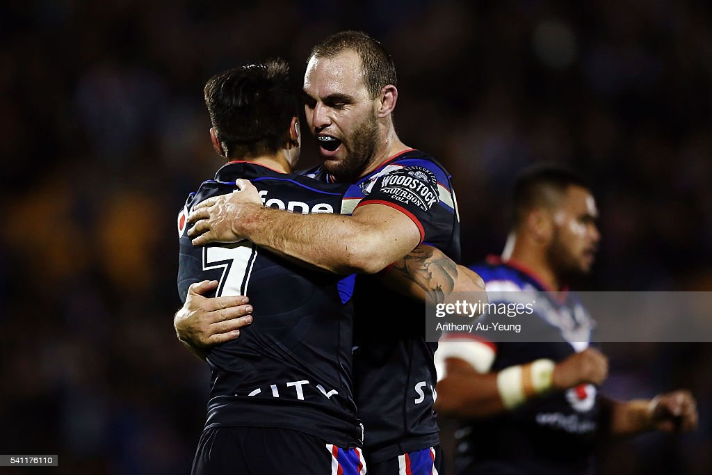 Simon Mannering and Shaun Johnson of the Warriors celebrate after winning the round 15 NRL match between the New Zealand Warriors and the Sydney Roosters at Mt Smart Stadium on June 19, 2016 in Auckland, New Zealand.