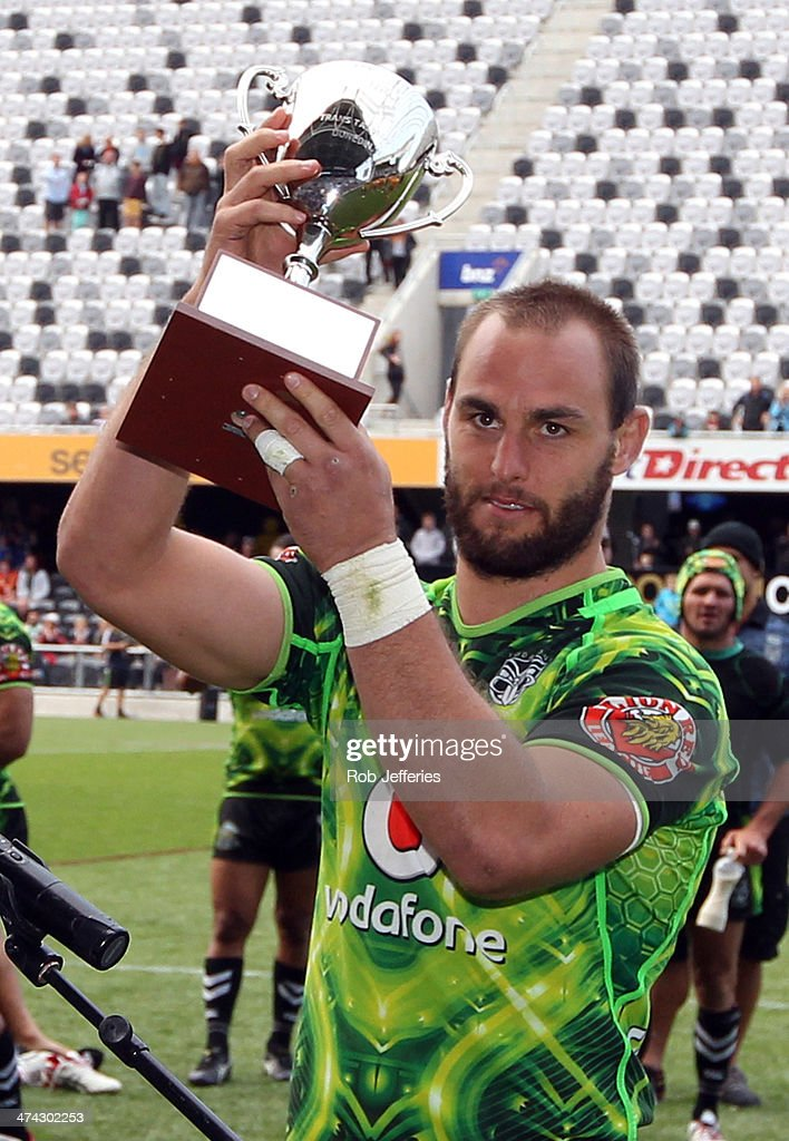 Simon Mannering, Captain of the Warriors holds up the TransTasman Cup after defeating the Brisbane Broncos during the NRL trial match between the Brisbane Broncos and the New Zealand Warriors at Forsyth Barr Stadium on February 23, 2014 in Dunedin, New Zealand.