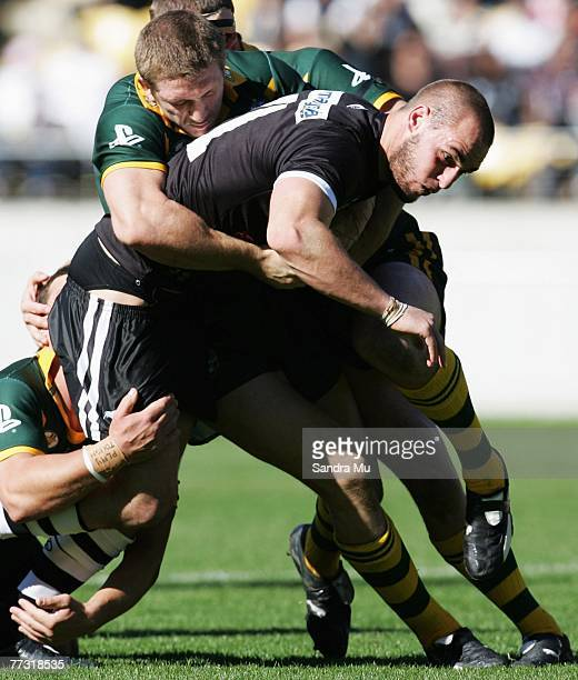 Simon Mannering of the Kiwis gets tackled during the Centennial Test match between the New Zealand Kiwis and the Australian Kangaroos at Westpac...