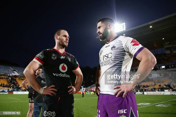 Simon Mannering of the Warriors catches up with Jesse Bromwich of the Storm after the round 19 NRL match between the New Zealand Warriors and the...