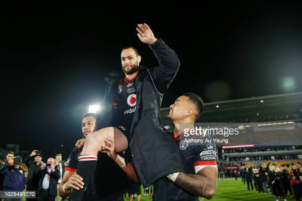 Simon Mannering of the Warriors is lifted up by his teammates as he comes off the field after winning in his 300th match and the round 25 NRL match...