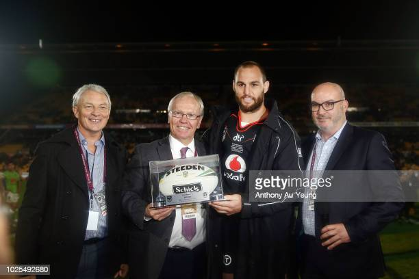Simon Mannering of the Warriors is presented with the match ball by Auckland Mayor Phil Goff Chairman of the Australian Rugby League Commission Peter...