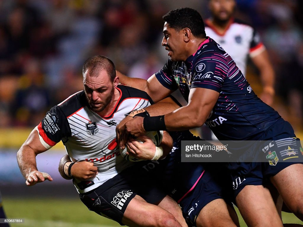 Simon Mannering of the Warriors is tackled by John Asiata and Jason Taumalolo of the Cowboys during the round 20 NRL match between the North Queensland Cowboys and the New Zealand Warriors at 1300SMILES Stadium on July 22, 2017 in Townsville, Australia.