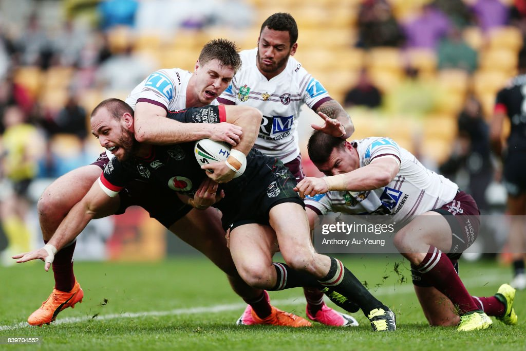 Simon Mannering of the Warriors is tackled by Shaun Lane of the Sea Eagles during the round 25 NRL match between the New Zealand Warriors and the Manly Sea Eagles at Mt Smart Stadium on August 27, 2017 in Auckland, New Zealand.