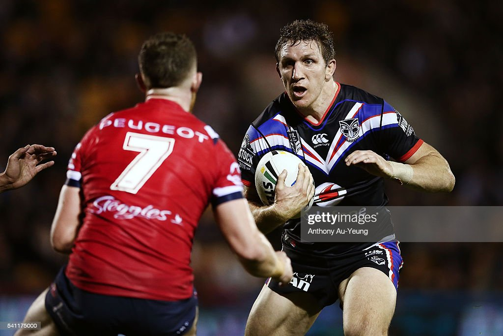 Simon Mannering of the Warriors makes a run at Jackson Hastings of the Roosters during the round 15 NRL match between the New Zealand Warriors and the Sydney Roosters at Mt Smart Stadium on June 19, 2016 in Auckland, New Zealand.