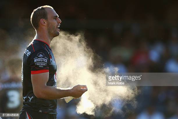 Simon Mannering of the Warriors sprays his hands during the round one NRL match between the Wests Tigers and the New Zealand Warriors at Campbelltown...