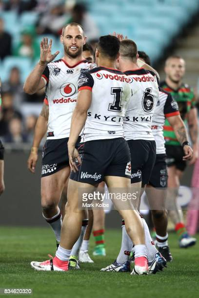 Simon Mannering Roger TuivasaSheck and Kieran Foran of the Warriors clebrate a try scored by Roger TuivasaSheck during the round 24 NRL match between...