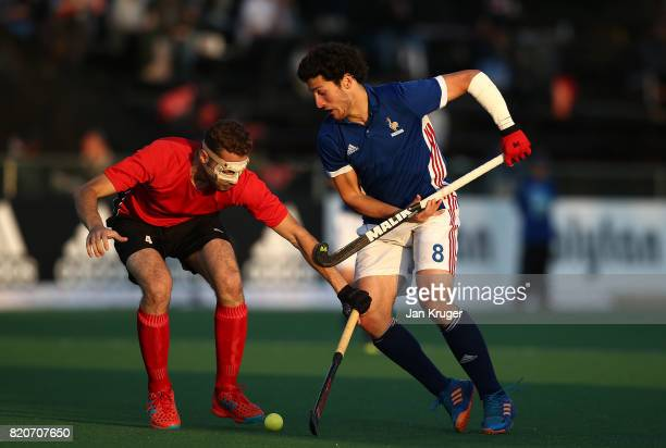 Simon Martin Brisac of France battles with Karim Atef of Egypt during day 8 of the FIH Hockey World League Men's Semi Finals 5th/ 6th place match...