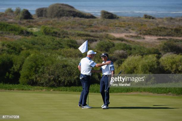 Simon McLean of Airdrie Golf Club and Brian Jamieson Captian of Airdrie Golf Club celebrate on the 14th green during Day One of the SkyCaddie PGA...