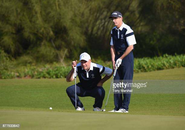 Simon McLean of Airdrie Golf Club and Brian Jamieson Captian of Airdrie Golf Club line up a putt on the 5th green during Day Two of the SkyCaddie PGA...