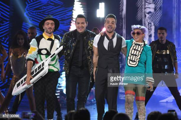 Simon Mejia Victor Manuelle Luis Fonsi and Li Saumet perform onstage at the 18th Annual Latin Grammy Awards at MGM Grand Garden Arena on November 16...