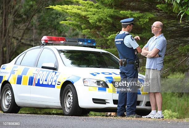 Simon Mercep Stepfather of Cem Erbay talks with Police at the scene where a body was found in bushland at Matarangi Beach on January 4 2011 in...