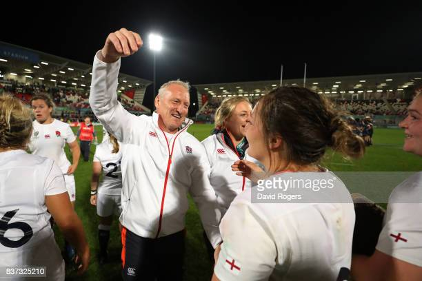 Simon Middleton the head coach of England celebrates with his players following their team's 203 victory during the Women's Rugby World Cup 2017 Semi...