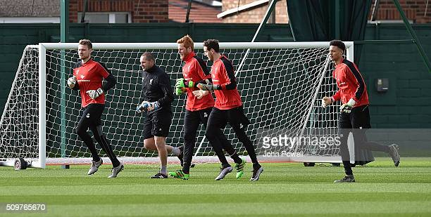 Simon Mignolet Adam Bogdan and Danny Ward of Liverpool during a training session at Melwood Training Ground on February 12 2016 in Liverpool England