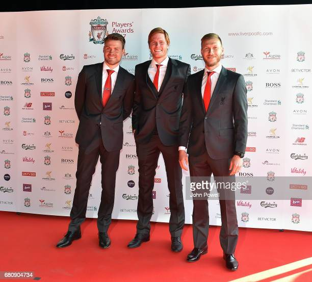 Simon Mignolet Adam Bogdan and Ragnar Klavan of Liverpool arrive at the Liverpool FC Player Awards with their wives at Anfield on May 9 2017 in...