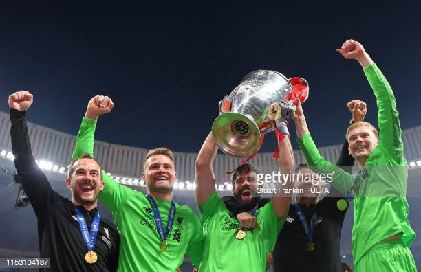 Simon Mignolet Alisson and Caoimhin Kelleher of Liverpool and staff celebrate with the Champions League Trophy after winning the UEFA Champions...