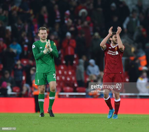 Simon Mignolet and Adam Lallana of Liverpool showing their appreciation to the fans at the end of the Premier League match between Liverpool and...