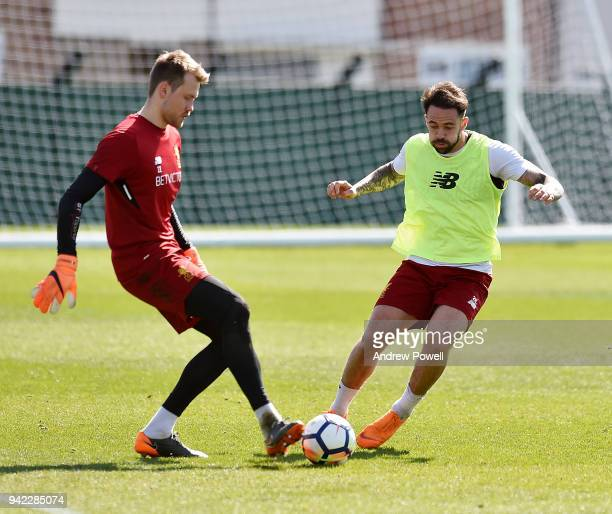 Simon Mignolet and Danny Ings of Liverpool during a training session at Melwood Training Ground on April 5 2018 in Liverpool England