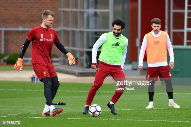 Simon Mignolet and Mohamed Salah of Liverpool during a training session at Melwood Training Ground on April 17 2018 in Liverpool England