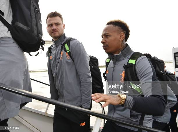 Simon Mignolet and Nathaniel Clyne of Liverpool board the plane for their trip to Porto at Liverpool John Lennon Airport on February 13 2018 in...