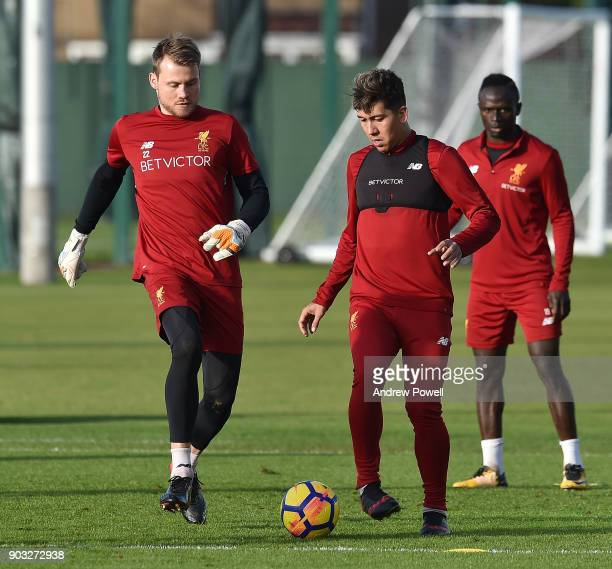 Simon Mignolet and Roberto Firmino of Liverpool during a training session at Melwood Training Ground on January 10 2018 in Liverpool England