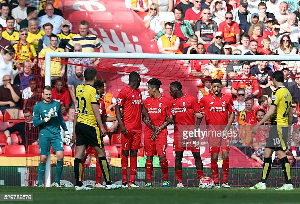 Simon Mignolet goalkeeper of Liverpool lines up a defensive wall during the Barclays Premier League match between Liverpool and Watford at Anfield on...