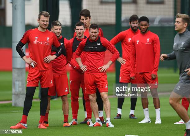 Simon Mignolet James Milner Andy Robertson and Adam Lallana of Liverpool during a training session at Melwood Training Ground on August 28 2018 in...