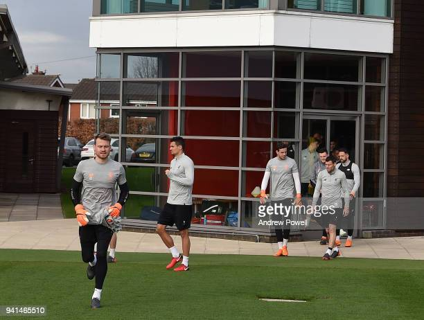 Simon Mignolet Leads the way out of Liverpool during a training session at Melwood Training Ground on April 3 2018 in Liverpool England