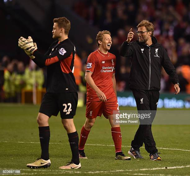 Simon Mignolet Lucas Leiva and Jurgen Klopp manager of Liverpool celebrate the win at the end of the Barclays Premier League match between Liverpool...