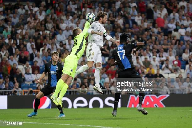 Simon Mignolet of Club Brugge competes for a header with Sergio Ramos of Real Madrid during the UEFA Champions League group A match between Real...