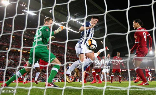 Simon Mignolet of Liverpool and an offside Gareth Barry of West Bromwich Albion watch on as Craig Dawson of West Bromwich Albion scores a goal which...