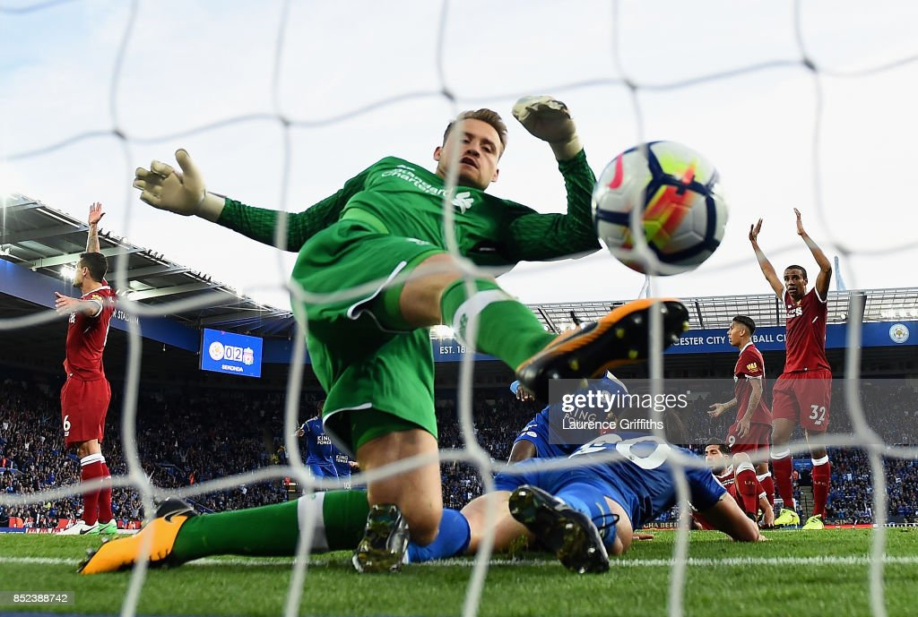 Simon Mignolet of Liverpool attempts to save as Shinji Okazaki of Leicester City scores his sides first goal during the Premier League match between Leicester City and Liverpool at The King Power Stadium on September 23, 2017 in Leicester, England.