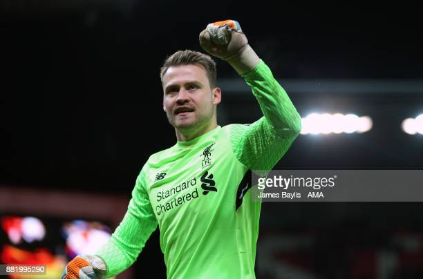 Simon Mignolet of Liverpool celebrates at full time after the Premier League match between Stoke City and Liverpool at Bet365 Stadium on November 29...