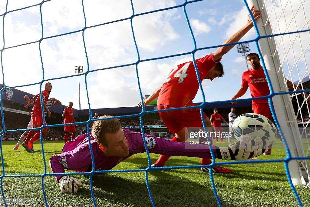 Simon Mignolet of Liverpool fails to prevent Eduardo Vargas of QPR scoring his team's second goal during the Barclays Premier League match between Queens Park Rangers and Liverpool at Loftus Road on October 19, 2014 in London, England.