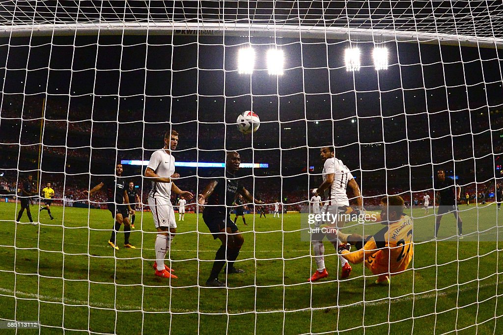 Simon Mignolet #22 of Liverpool FC gives up the game winning goal to Mohamed Salah #11 of AS Roma during a friendly match at Busch Stadium on August 1, 2016 in St Louis, Missouri. AC Roma won 2-1.