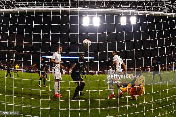 Simon Mignolet of Liverpool FC gives up the game winning goal to Mohamed Salah of AS Roma during a friendly match at Busch Stadium on August 1 2016...